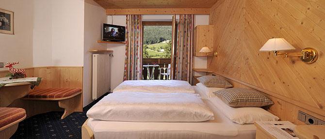 Bedroom at Hotel Digon Shiraz, French Alps Walking Holiday