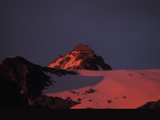 image: top of the grands montets by night