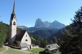 Above Ortisei the Church overlooks magnificent mountains