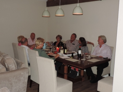 image: Pinnacle walking holidays guests enjoying dinner at Dale End Barn