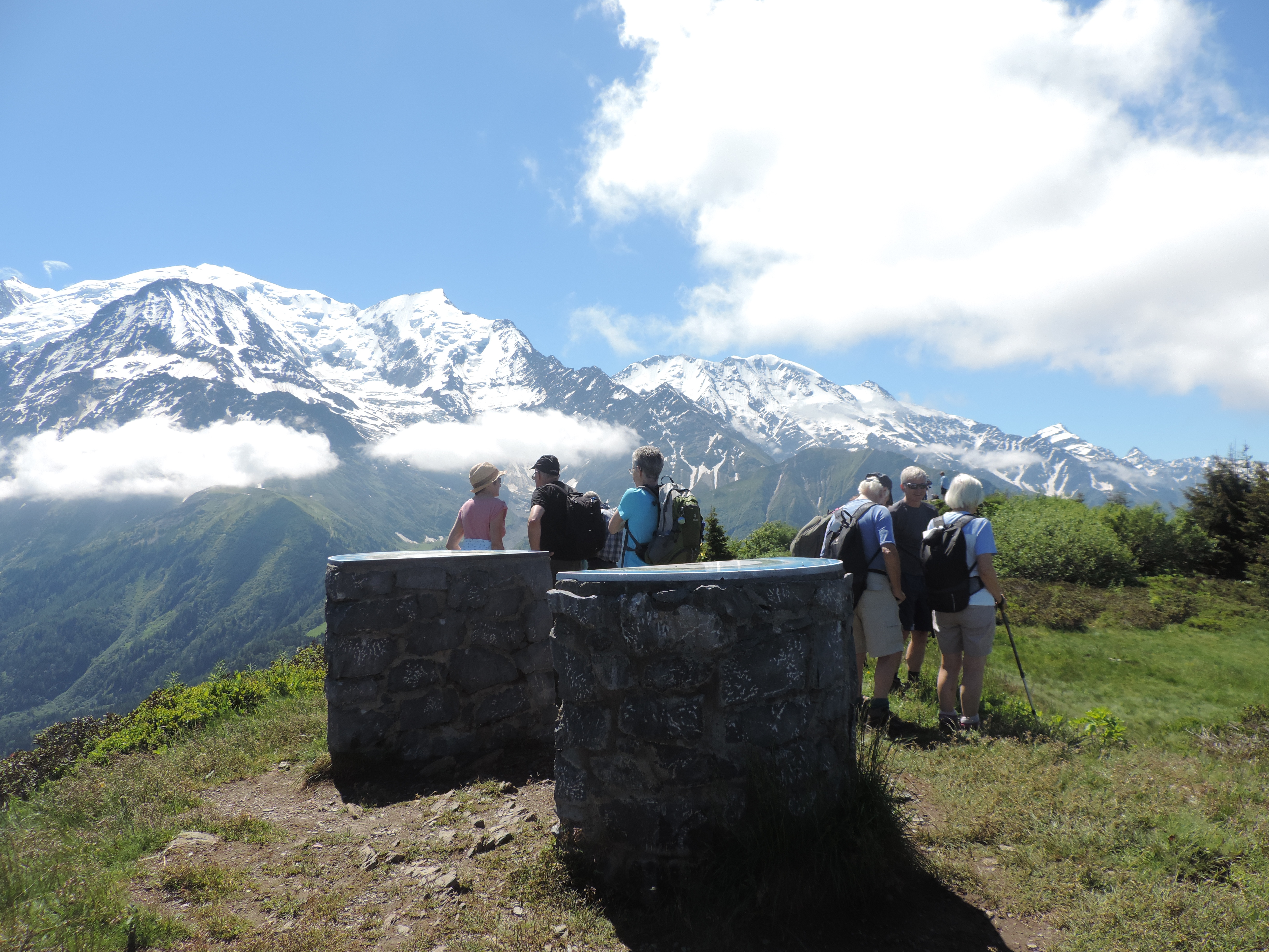 image: guests enjot the first days walk above Les Houches