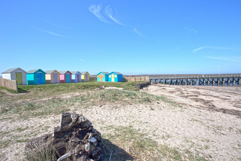 image: beach huts Amble